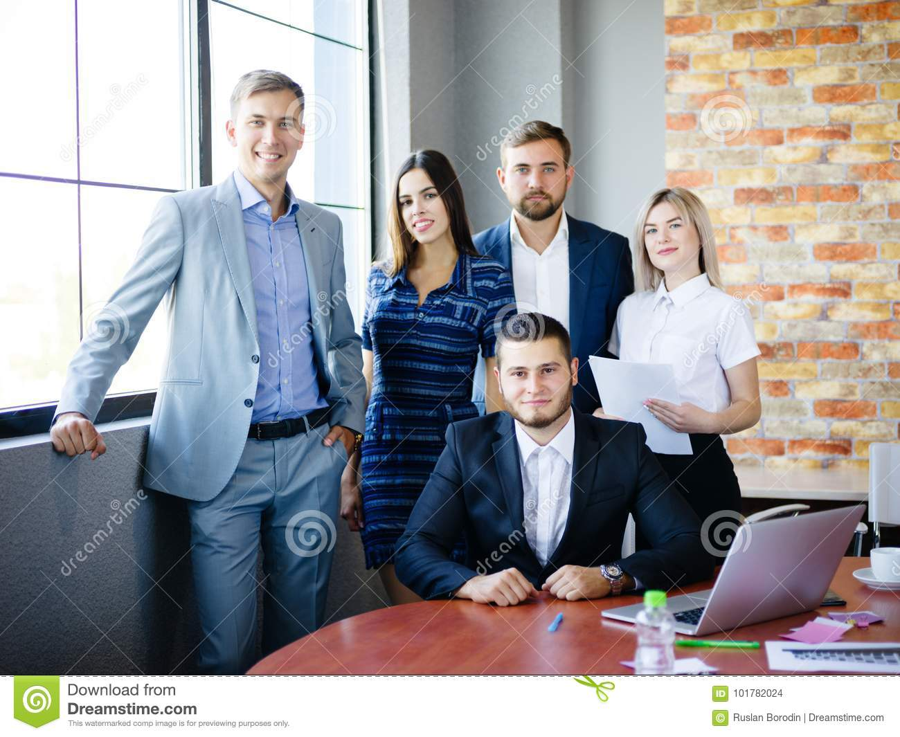 A Group Of Office Workers Examining Ideas In Office Stock Photo