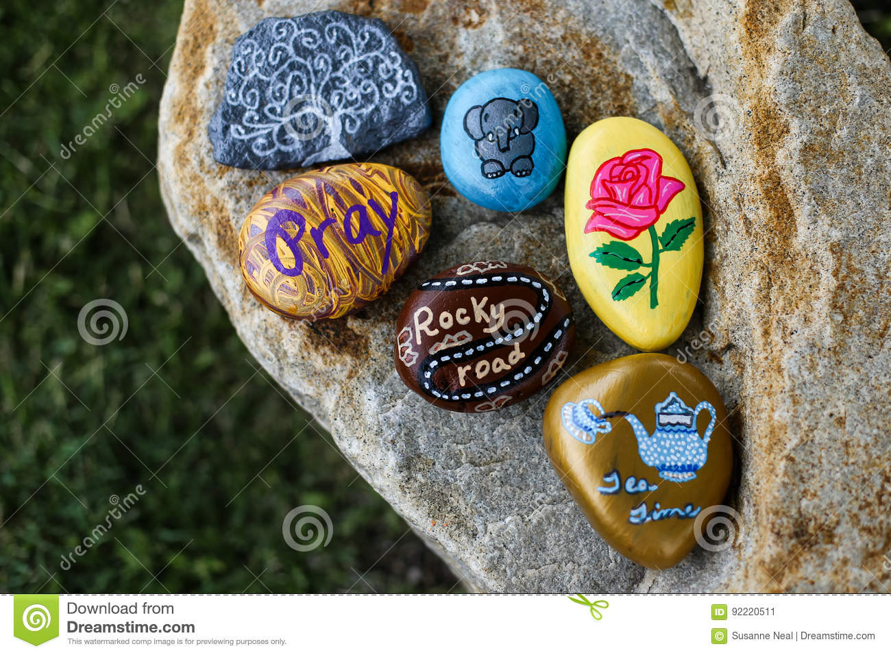 Group of painted rocks on a small boulder