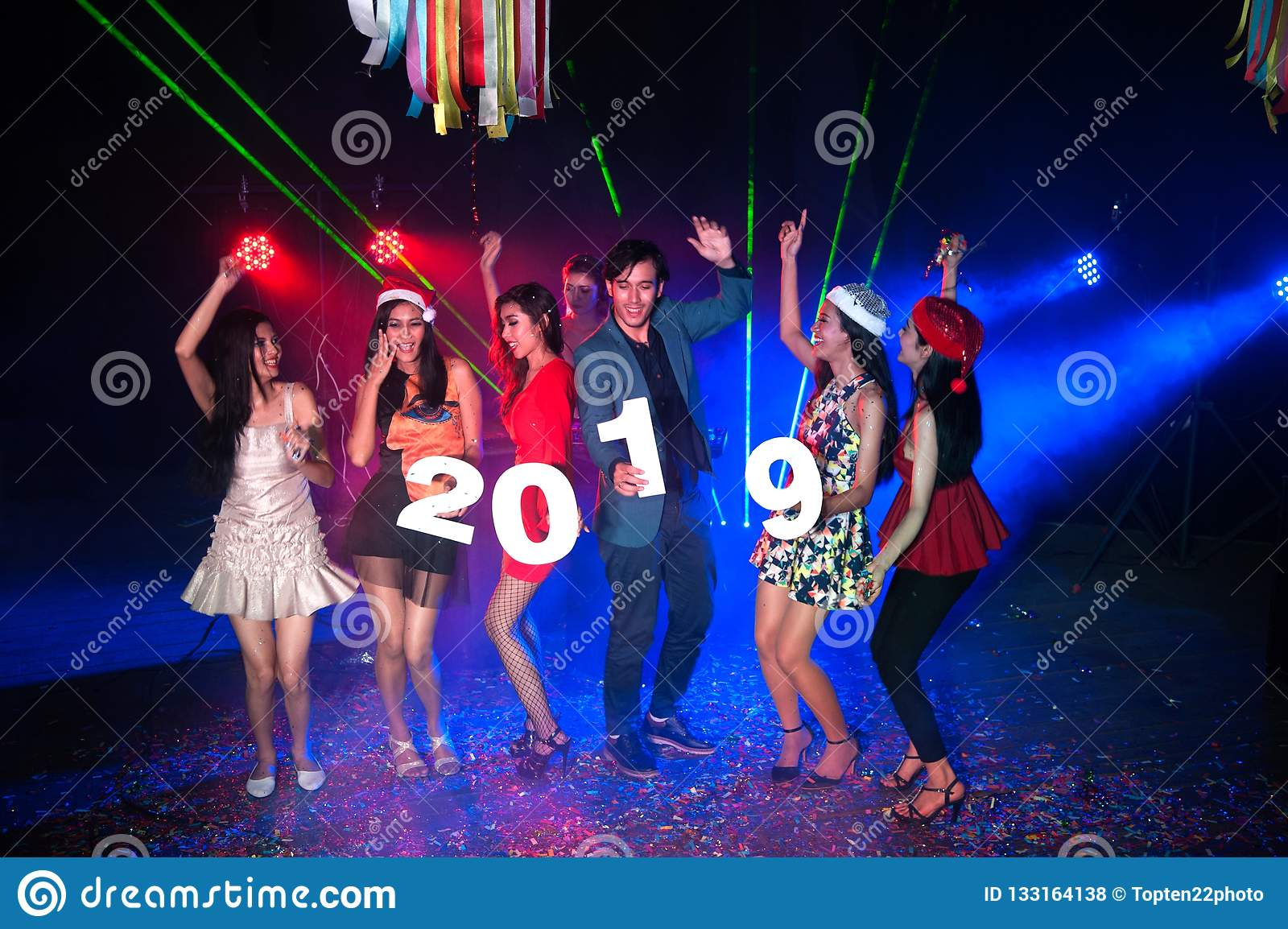 Group Of People Dancing At Night Club With Santa Hat Christmas Holidays.  Stock Photo - Image of friendship, dance: 133164138