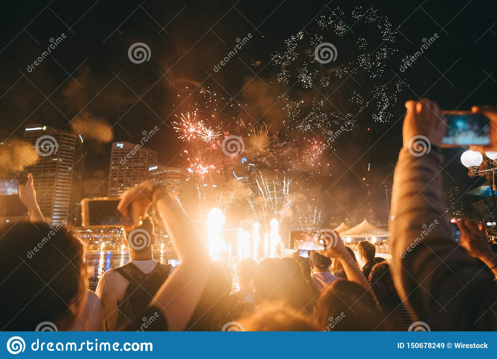 Group of people enjoying bright sparking fireworks at a festival