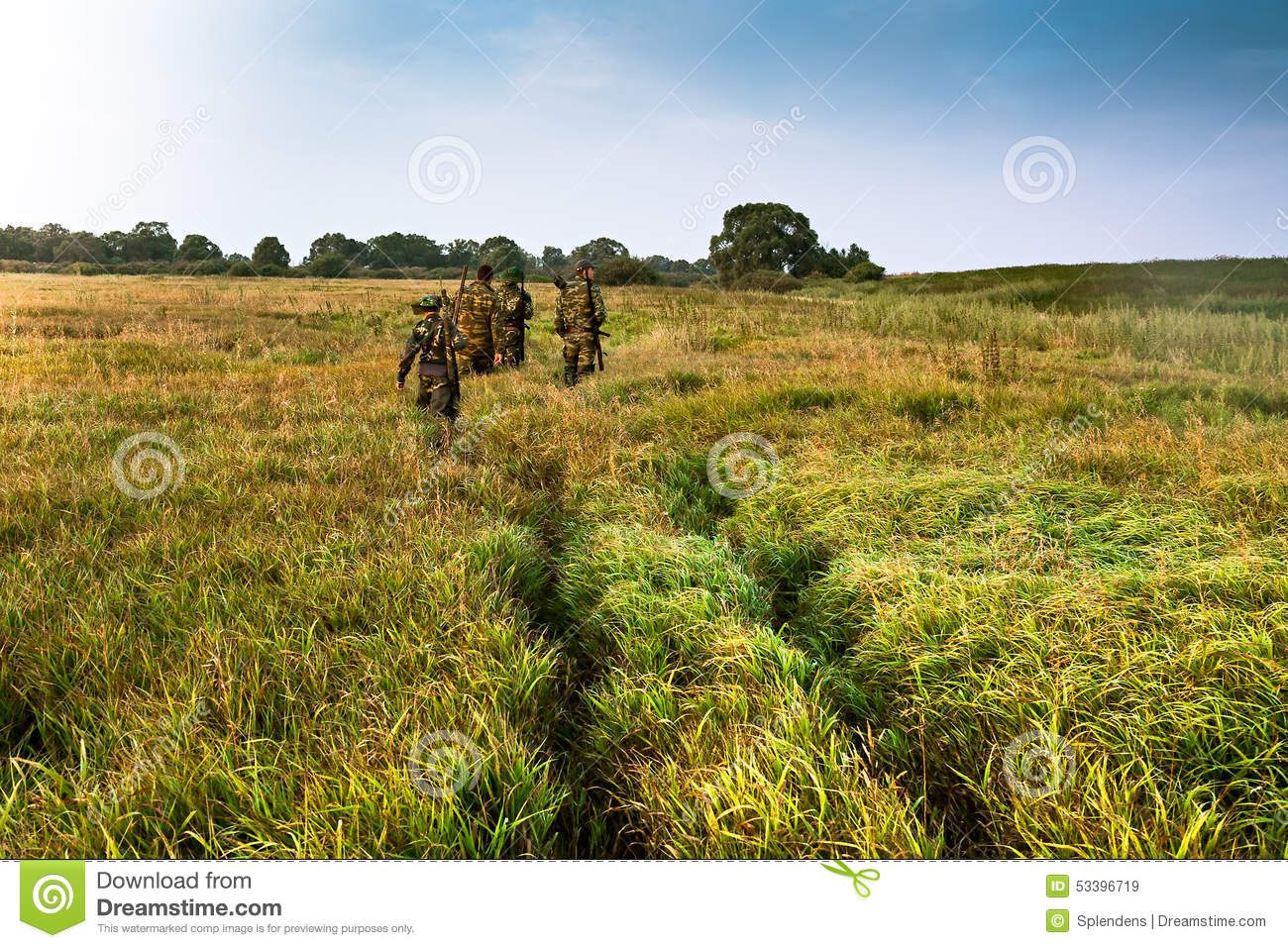 tall green grass field. Group Of People Going Into The Distance On A Green Field With Tall Grass During Sunrise L