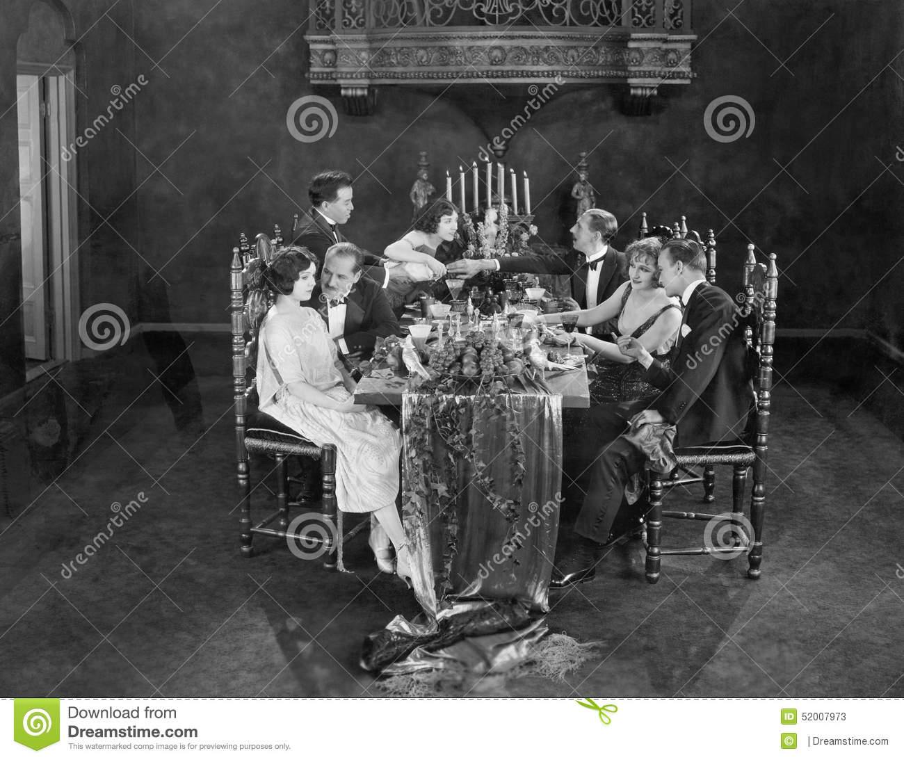 Group of people having dinner party