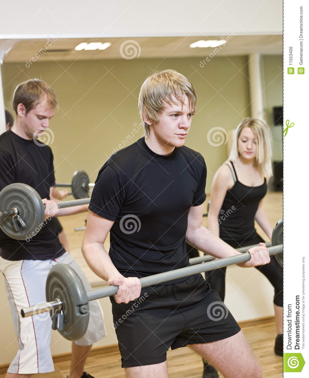 group of people lifting weights royalty free stock image