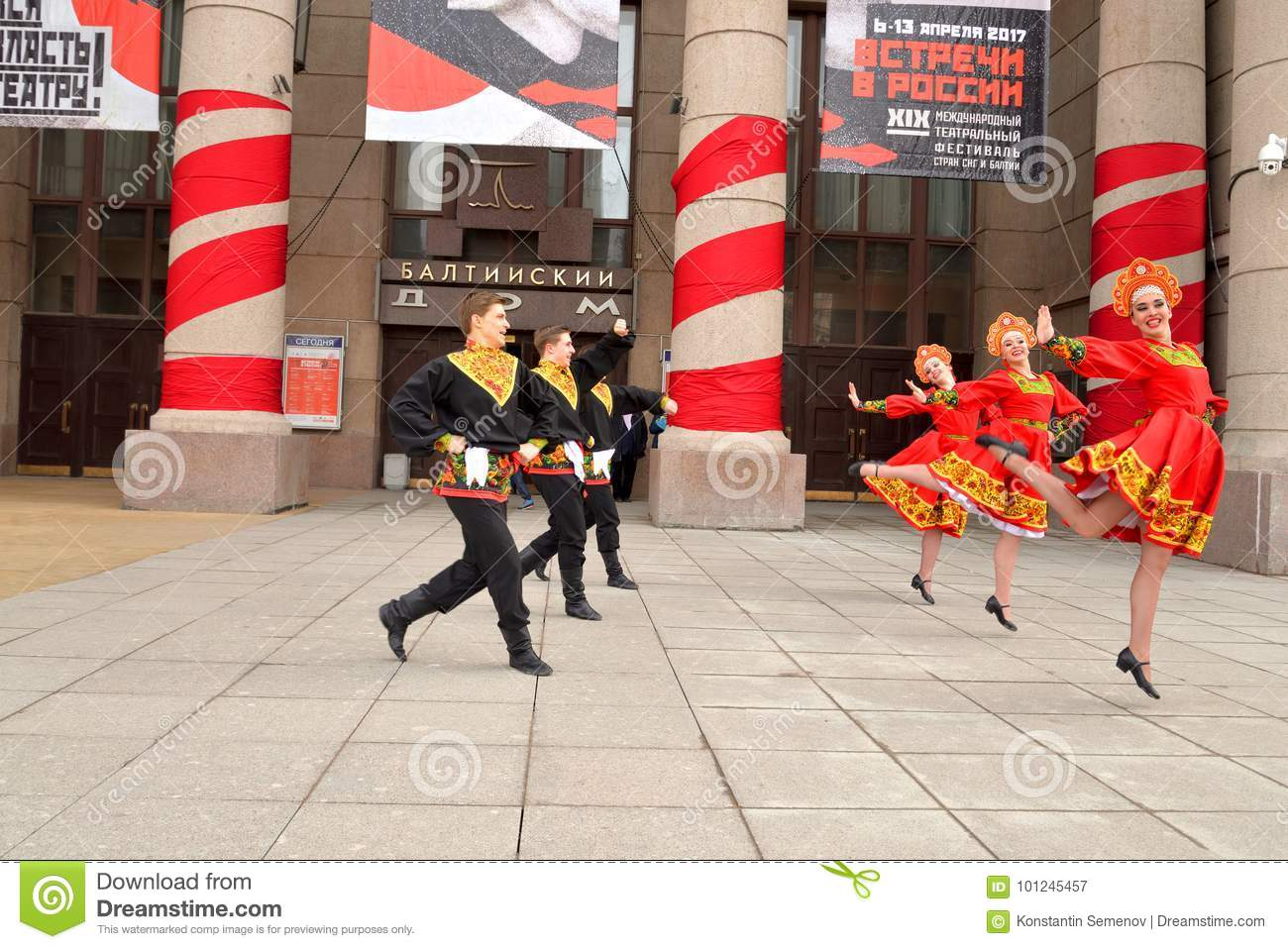 Group Of People In National Costumes Are Dancing Russian Dances