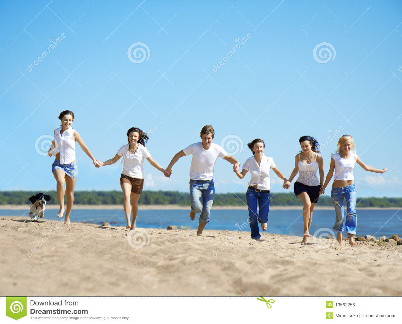 Group of people relaxing on the beach