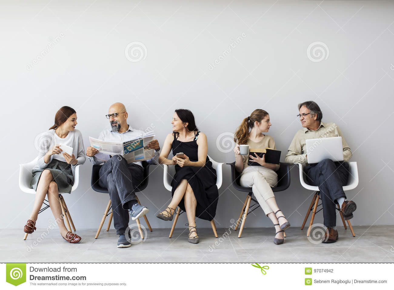 Group of people sitting on chairs