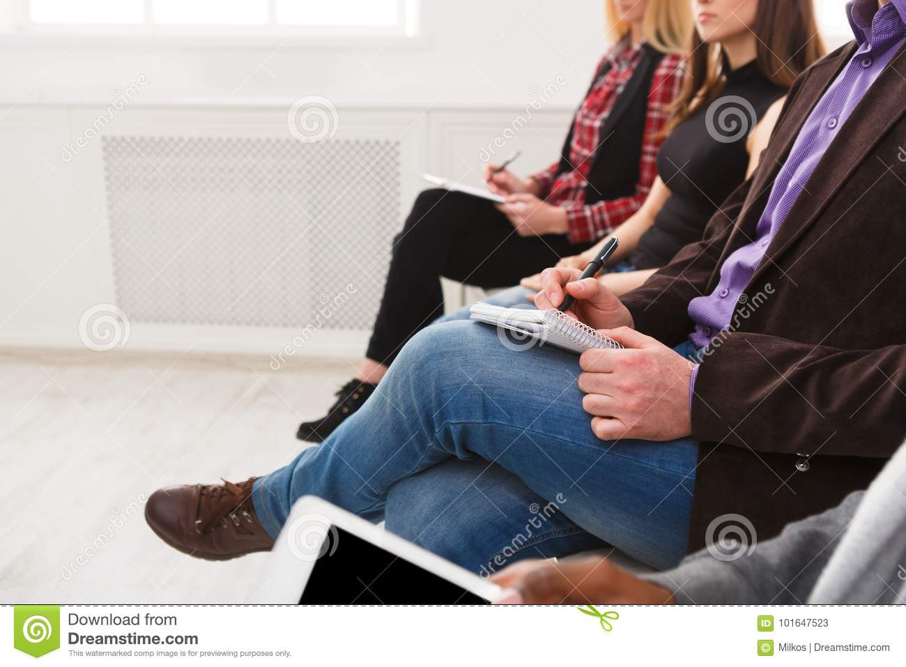 Group of people sitting at seminar, copy space