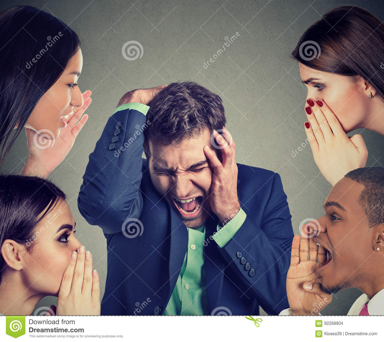 Group of people whispering to a desperate stressed business man