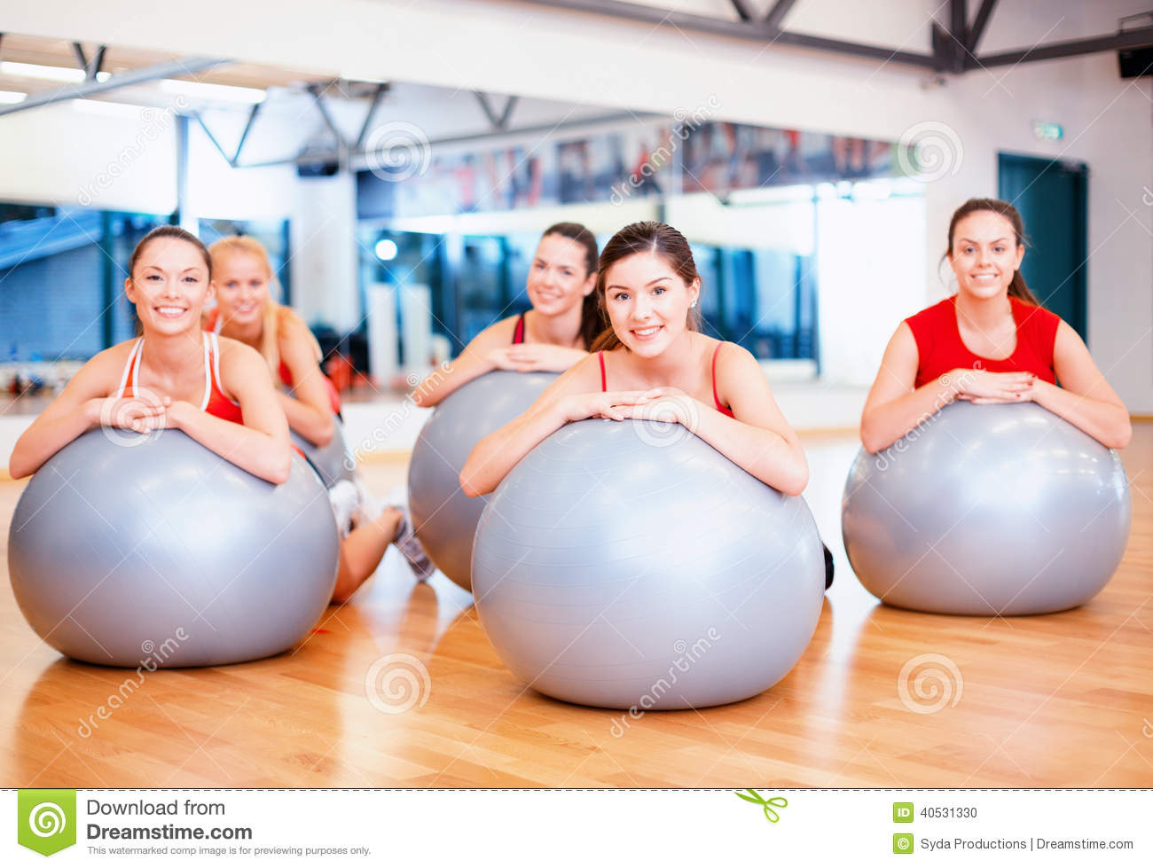Group of people working out in pilates class stock photo for Gimnasio pilates