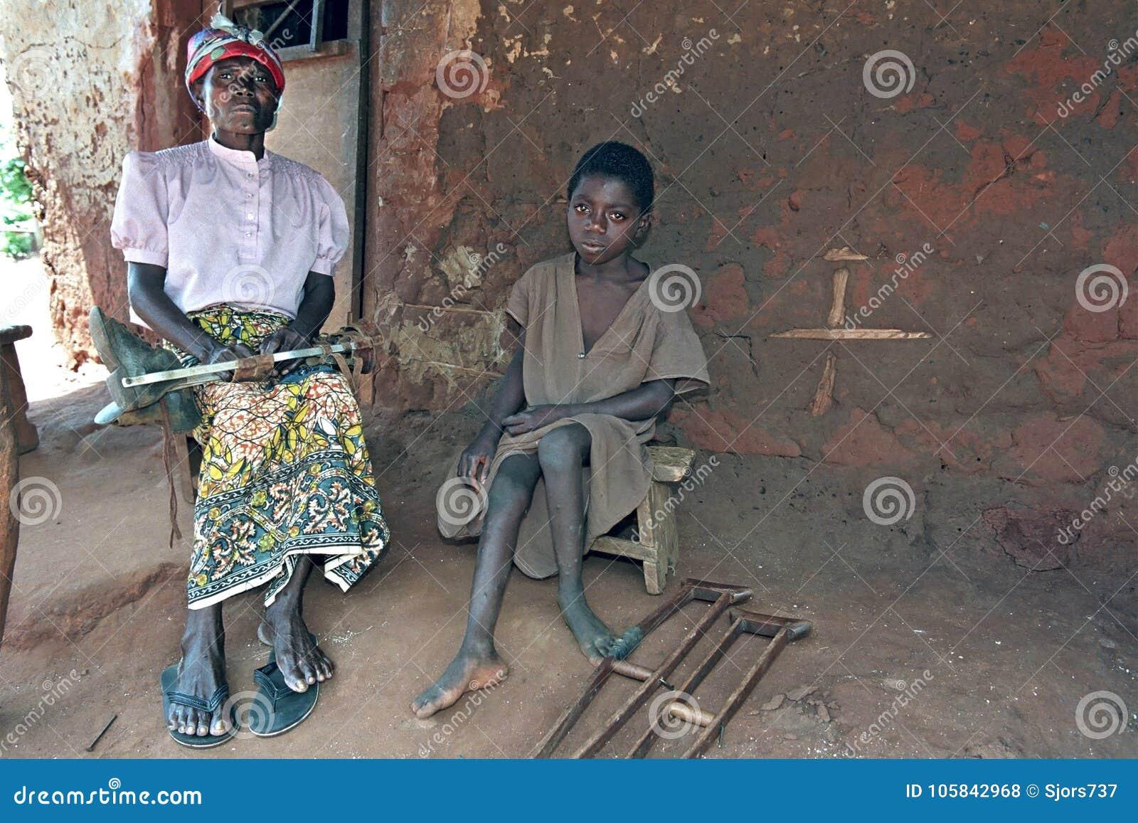 Group portrait of Ghanaian grandma and grandchild
