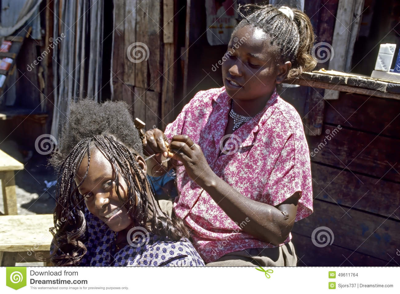Group portrait of hairdresser and laughing customer