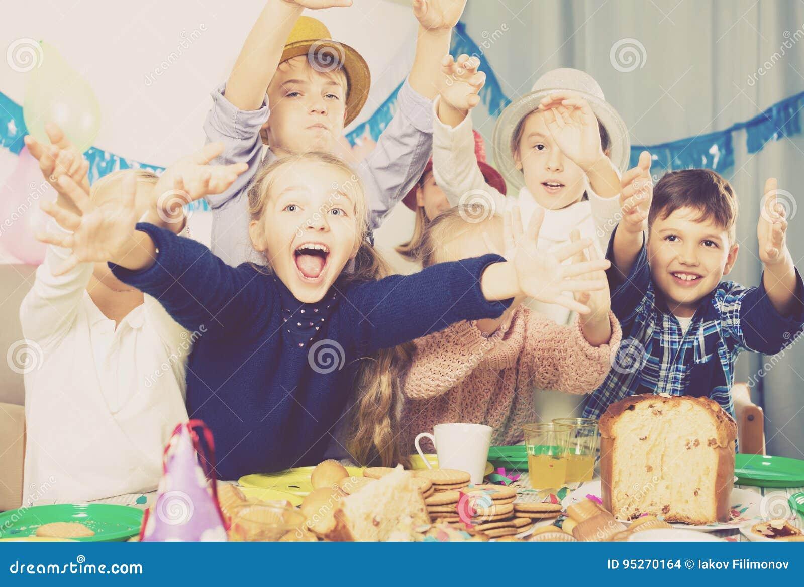 Group positive children having fun birthday party