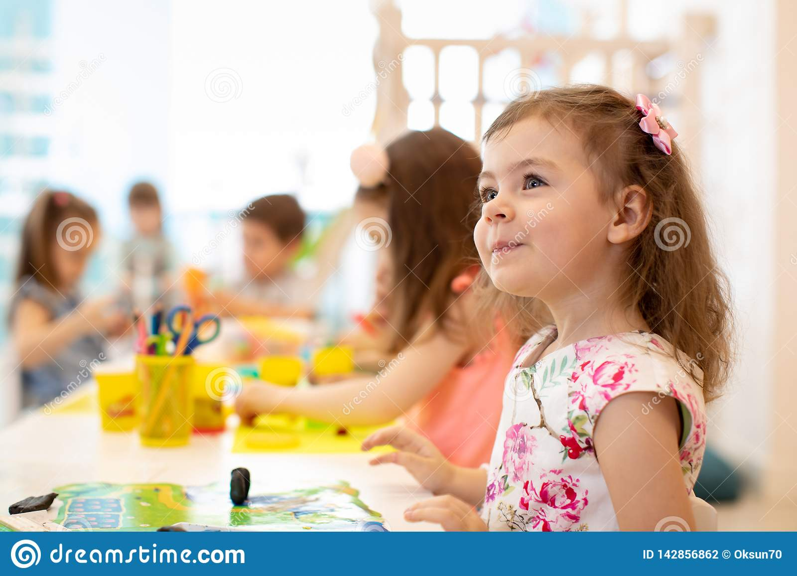 Group of preschool children engaged in drawing and crafts