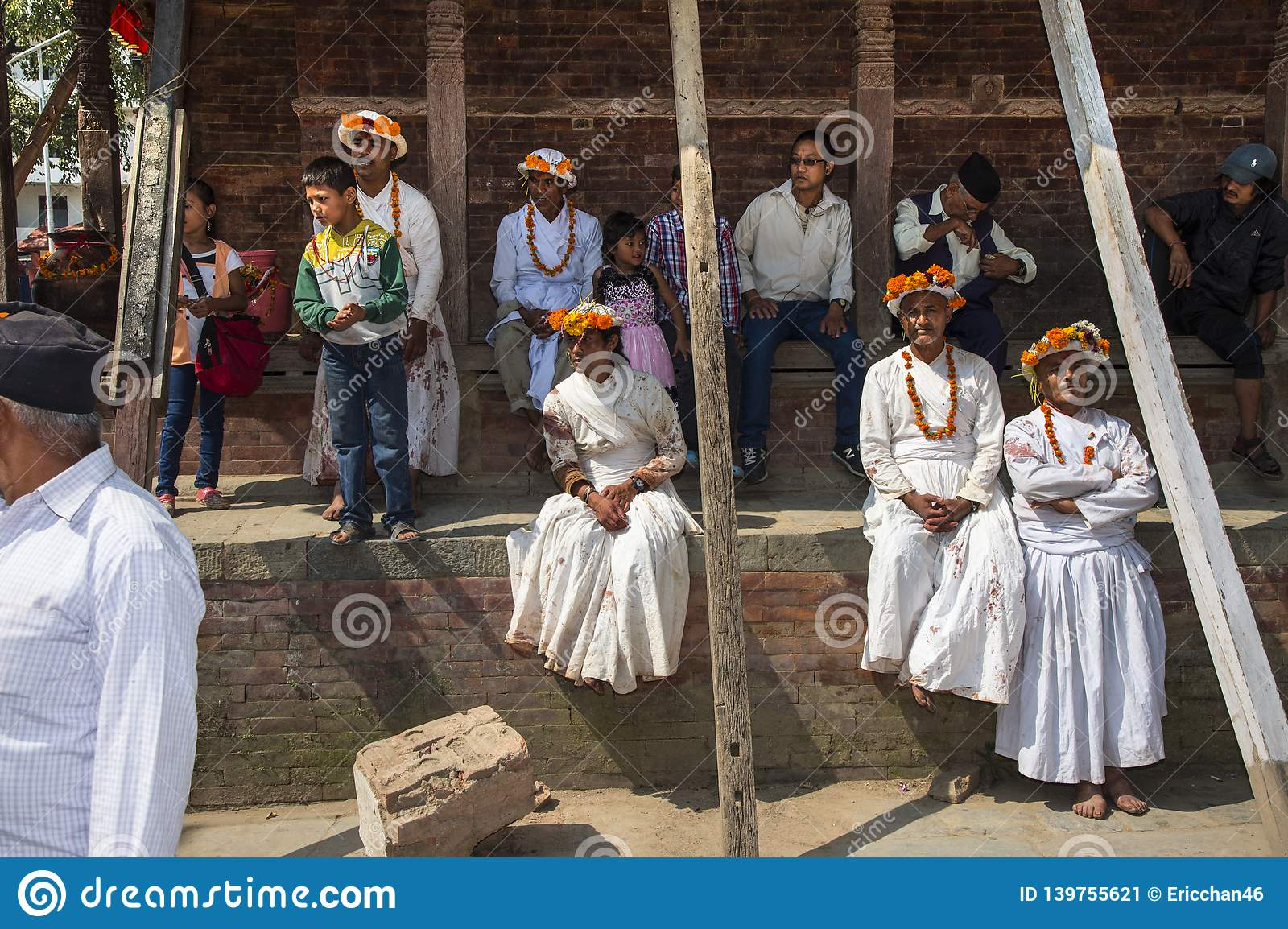 A group of priests have rest on footstep of temple , Dasain Festival , Kathmandu , Nepal