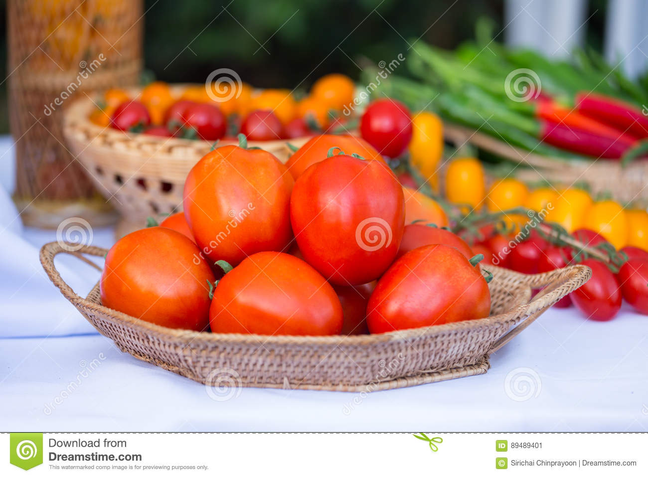 Group of ripe tomato in the basket