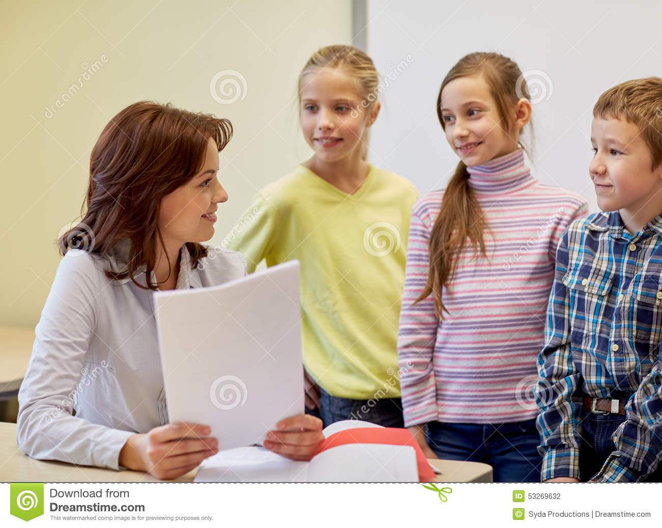 Group Of School Kids With Teacher In Classroom Stock Photo ...