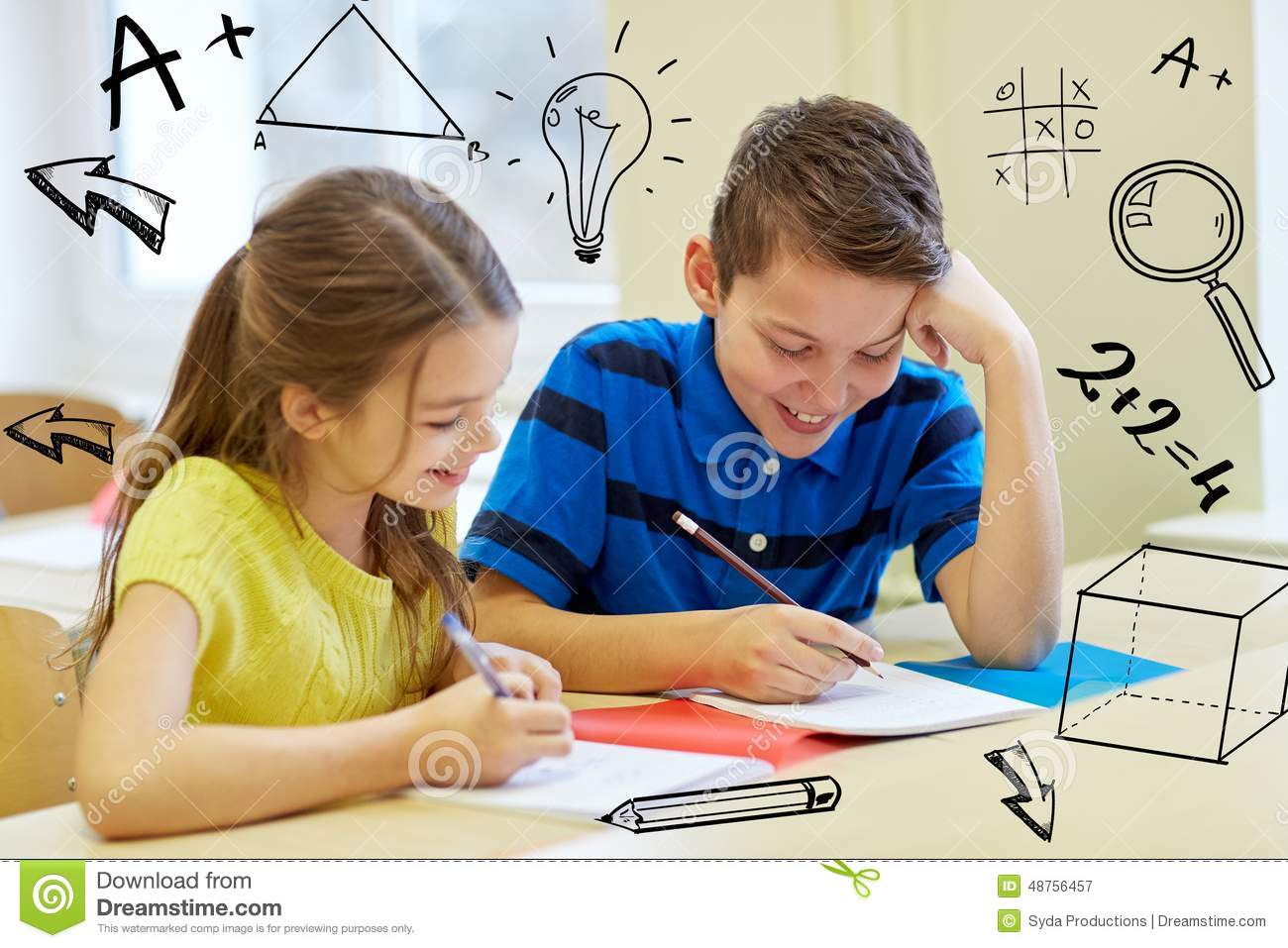 Elementary Classrooms Writing ~ Group of school kids writing test in classroom stock
