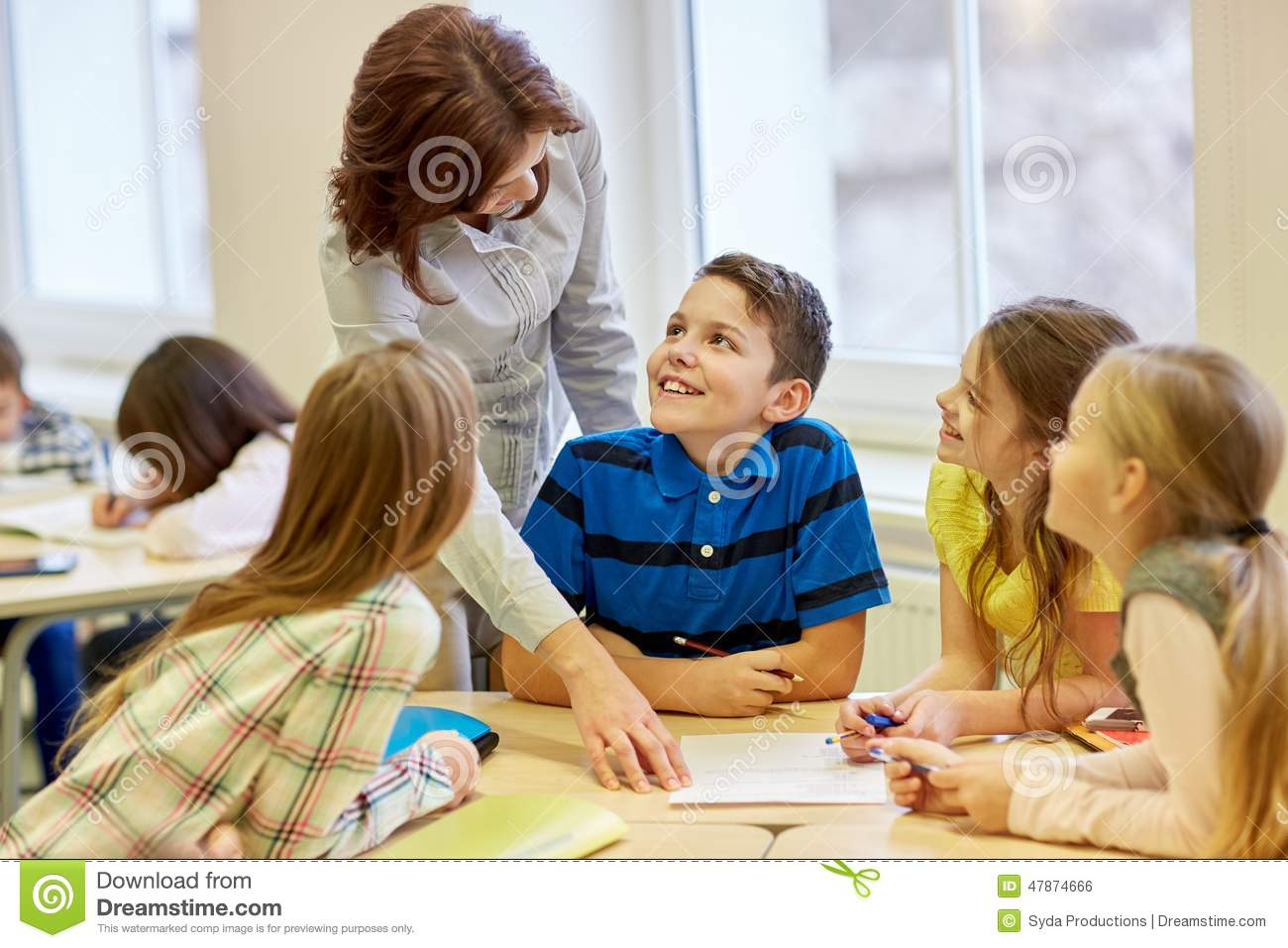 Classroom Design Effect On Learning ~ Group of school kids writing test in classroom stock photo