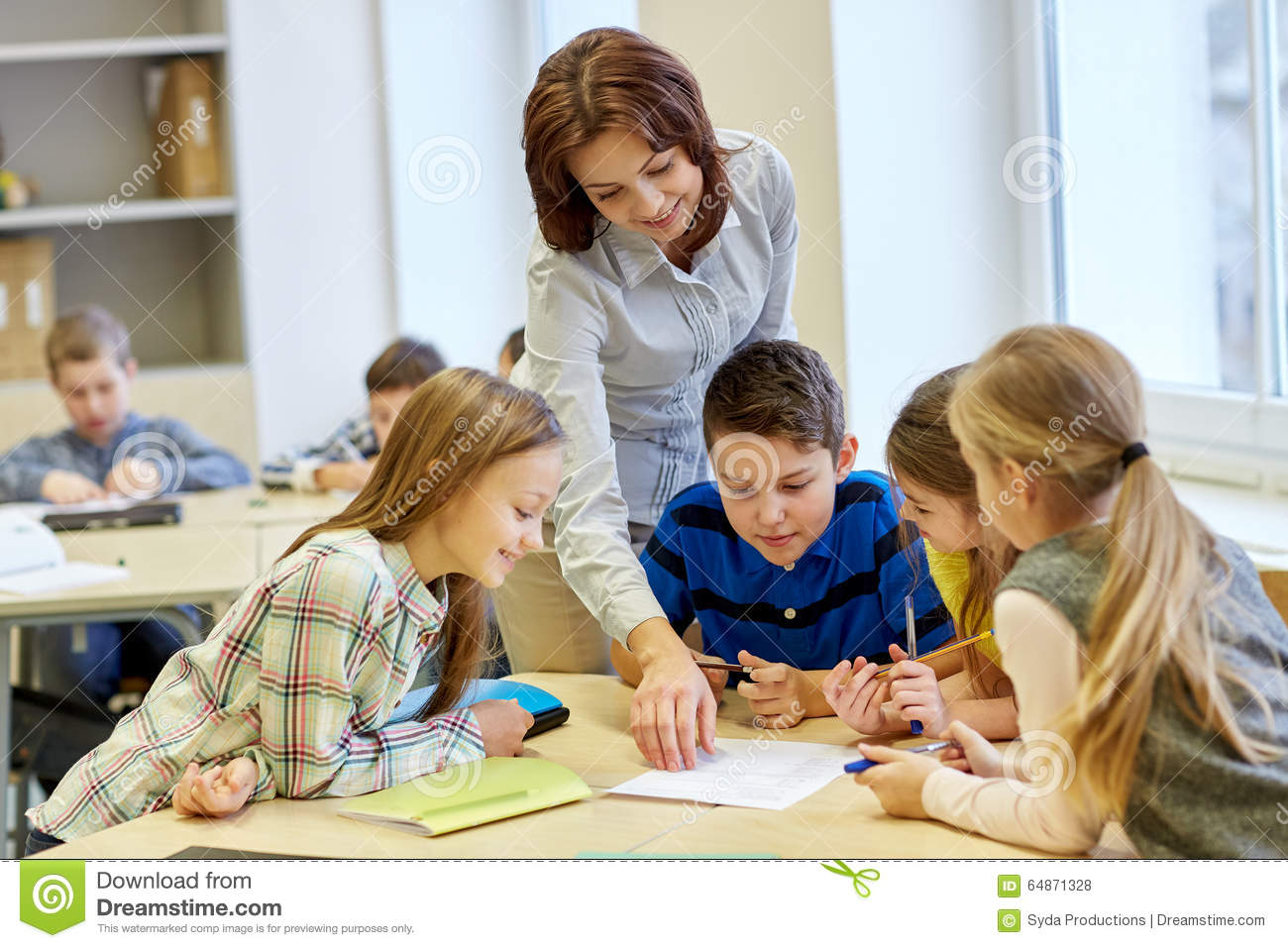 Elementary Classroom Students ~ Group of school kids writing test in classroom stock photo
