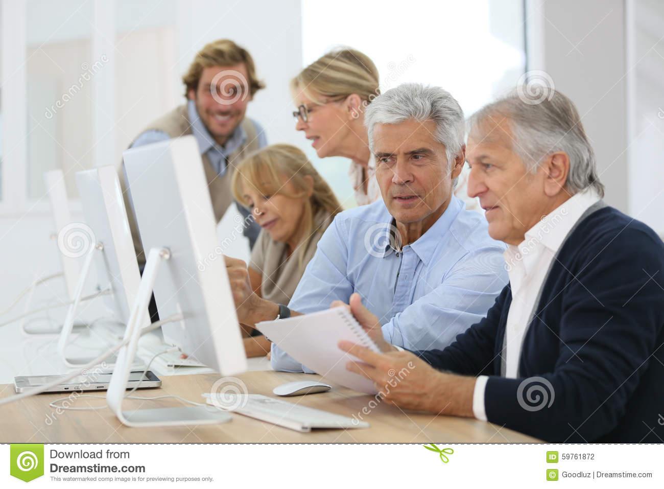 Group of seniors in business training course