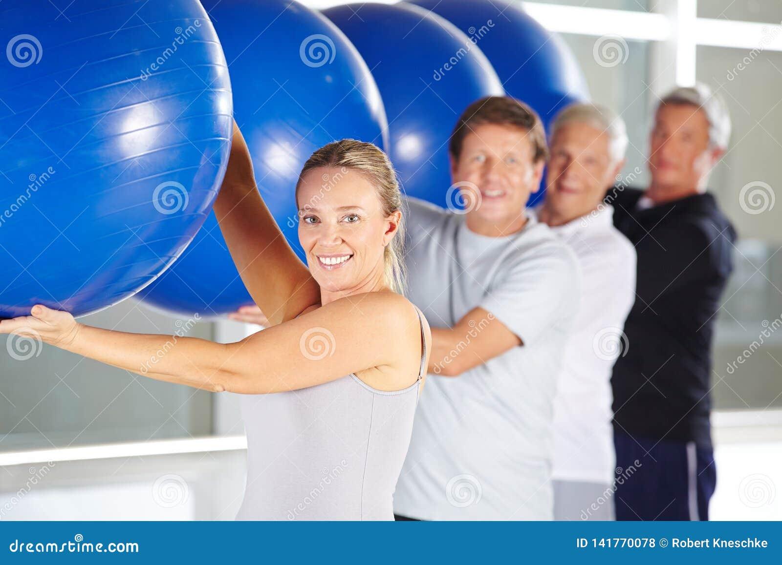 Group of seniors doing fitness training in the rehabilitation center