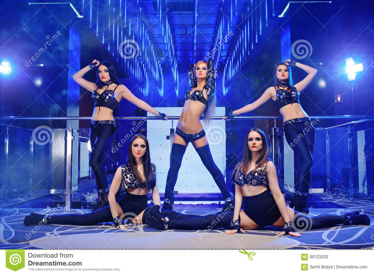 Group of go-go dancers wearing black outfits