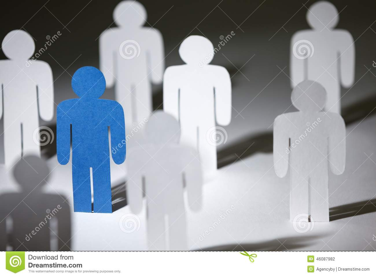 Group of similar paper people with a blue one