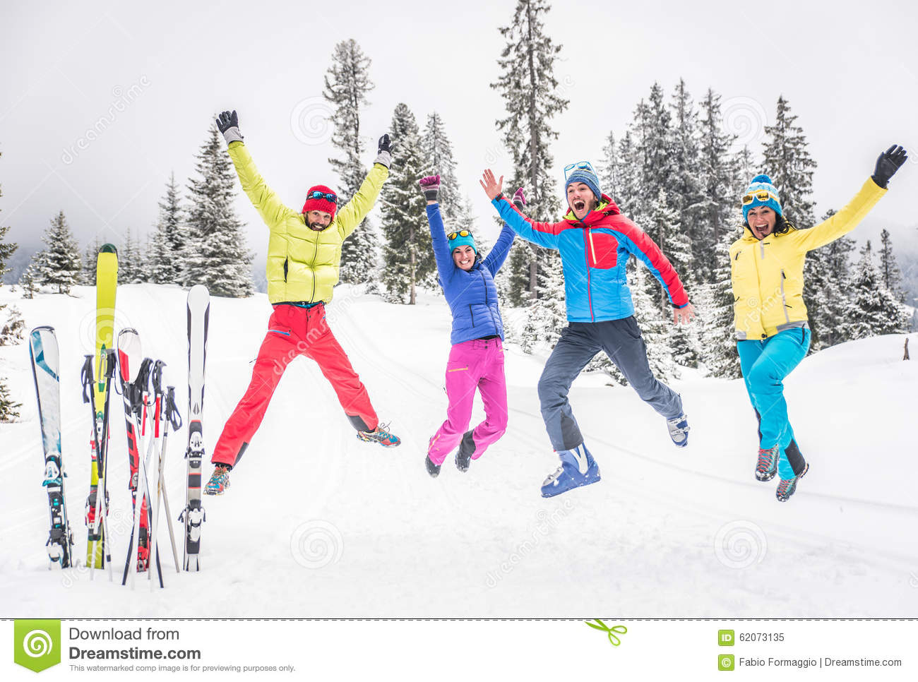 Group of skiers jumping on the snow