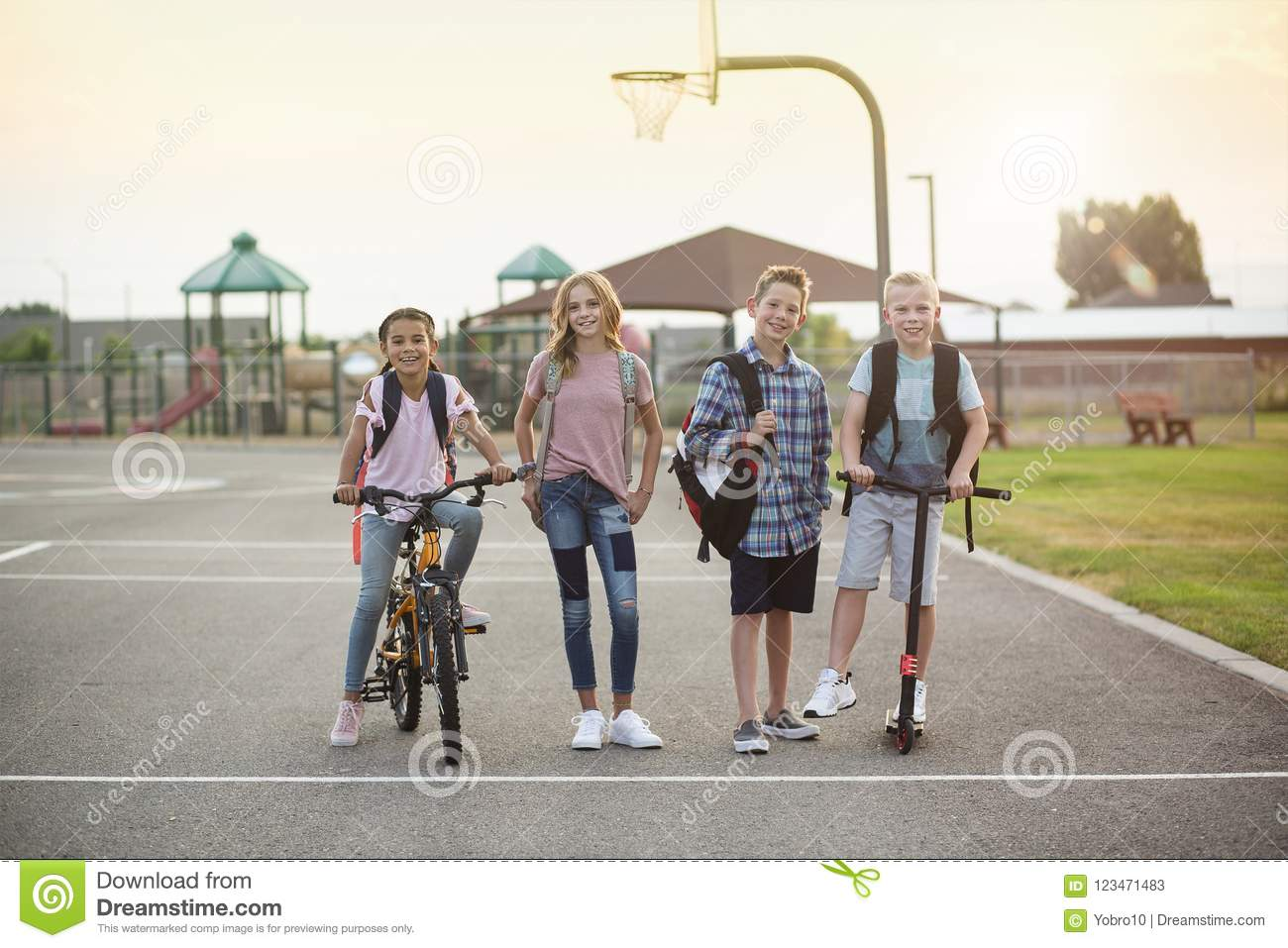 Group of smiling elementary school students on their way home
