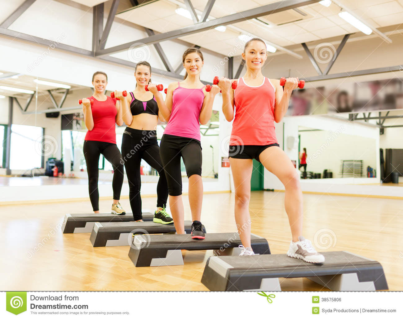 Group of smiling female with dumbbells and step royalty for Gimnasio sport gym