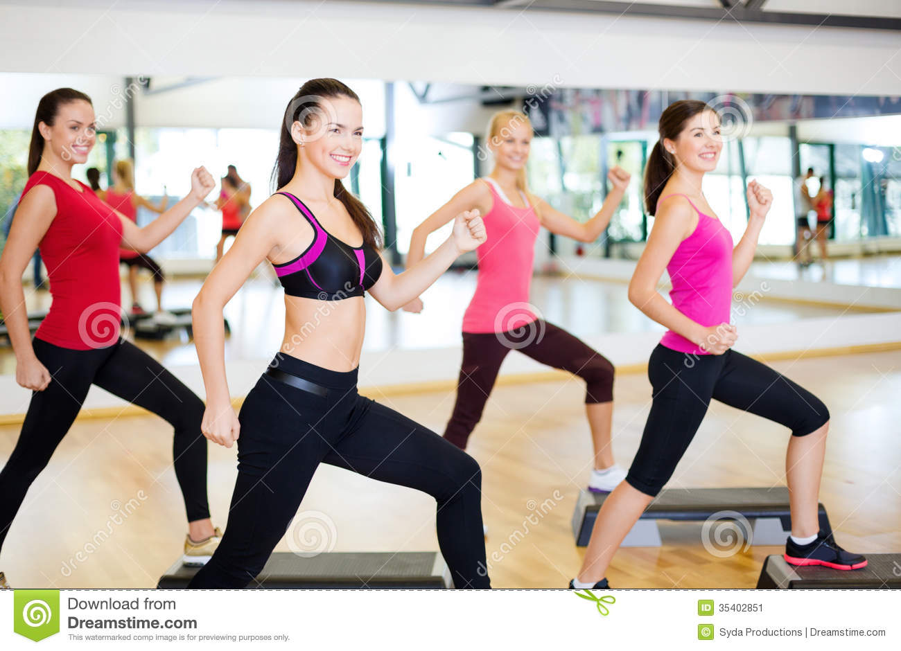 Group Of Smiling People Doing Aerobics Stock Image  Image: 35402851