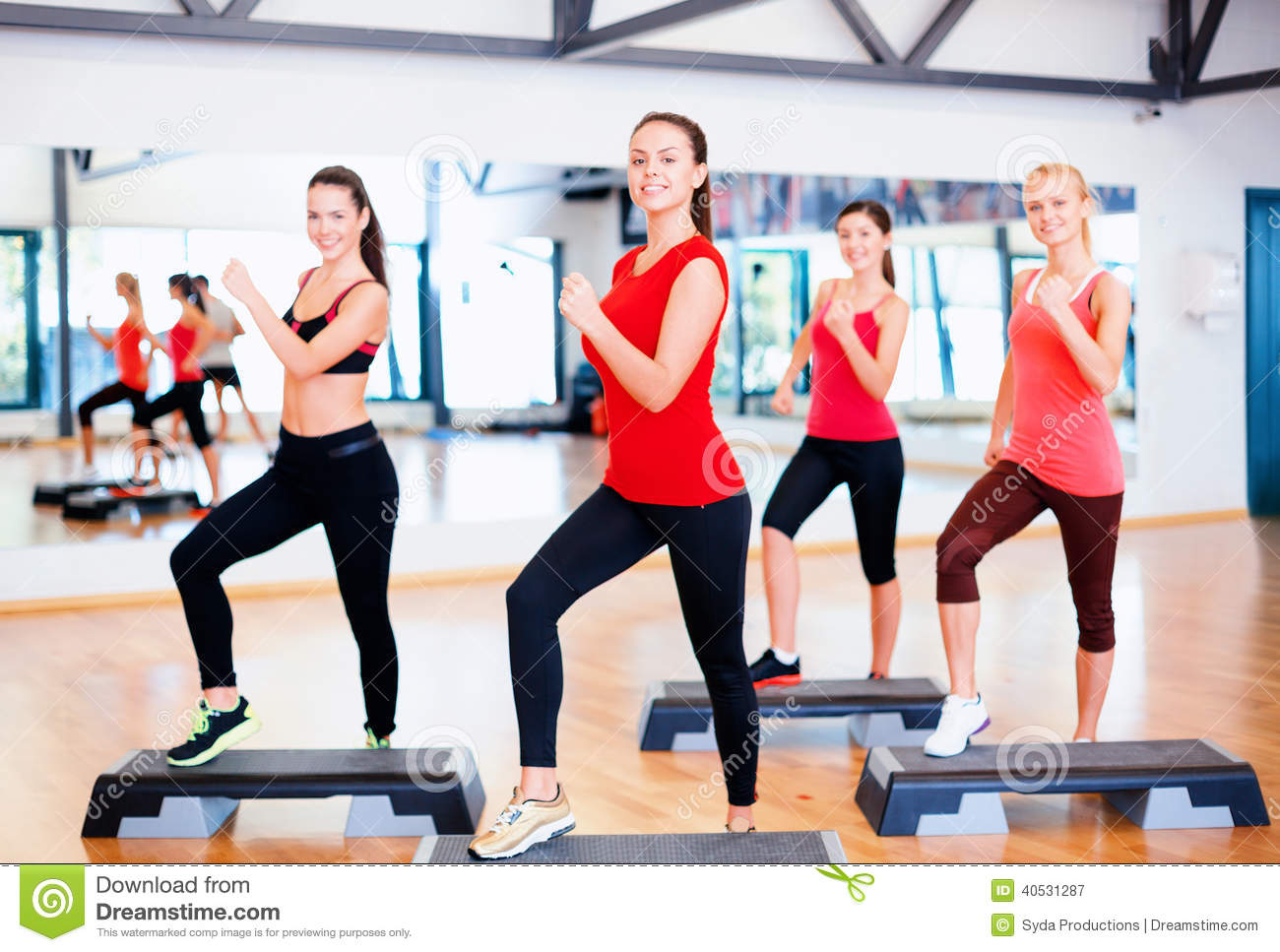 group of smiling people doing aerobics stock image image of attractive equipment 40531287. Black Bedroom Furniture Sets. Home Design Ideas