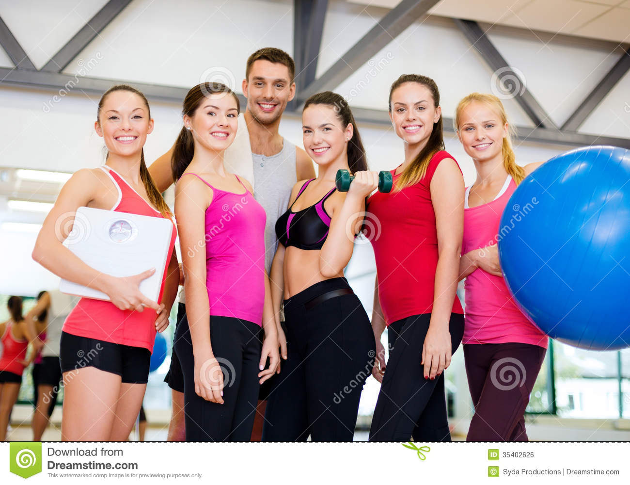 Group of smiling people in the gym stock photo image for Gym life fitness