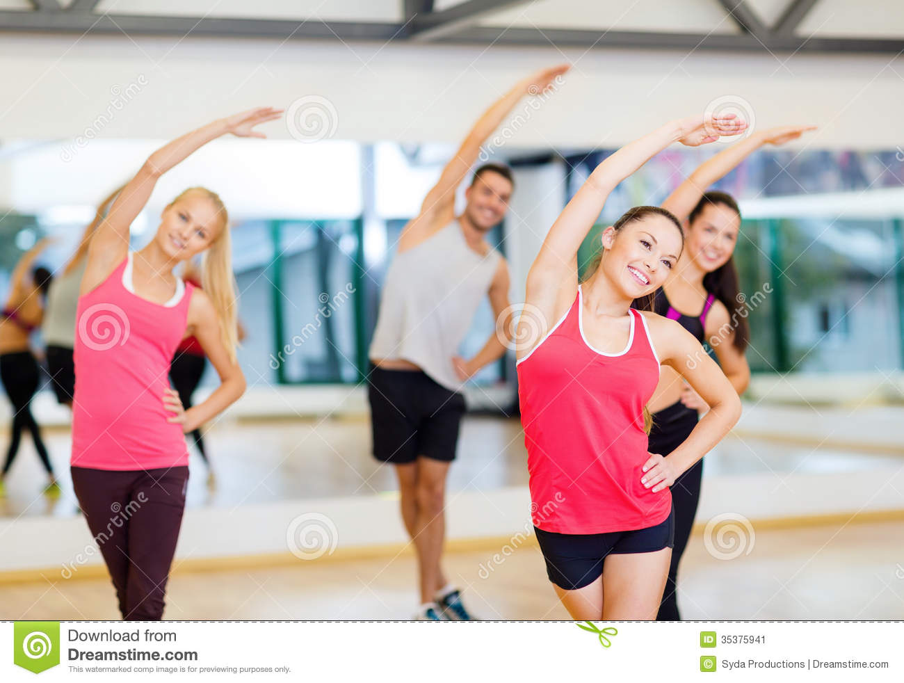 Group of smiling people stretching in the gym stock image for Gimnasio sport gym