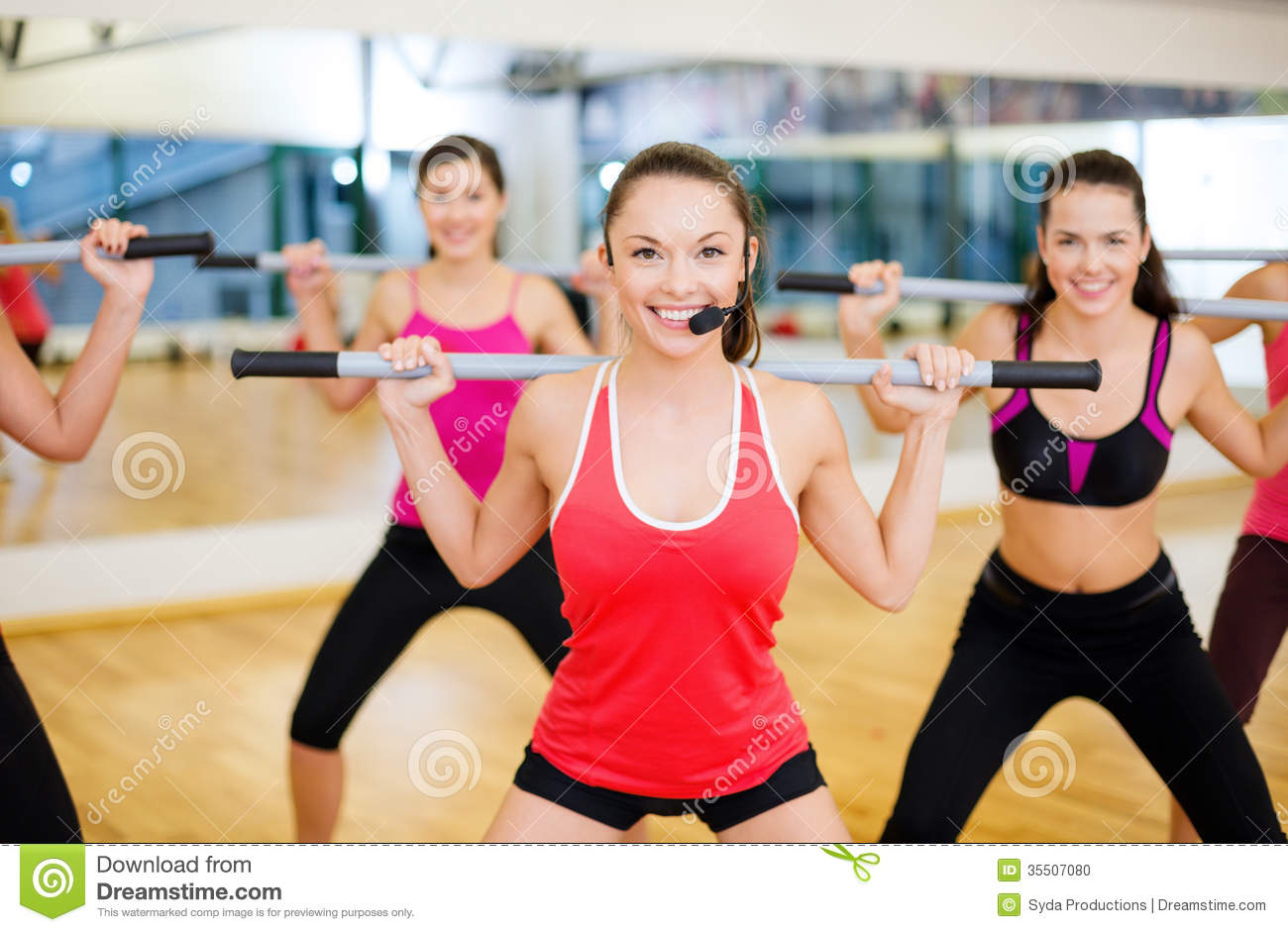 Group Of Smiling People Working Out With Barbells Stock