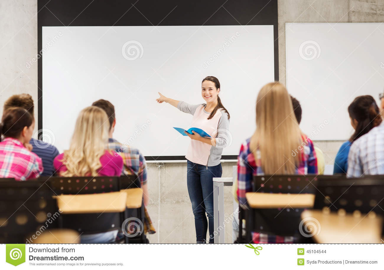group of smiling students in classroom stock photo