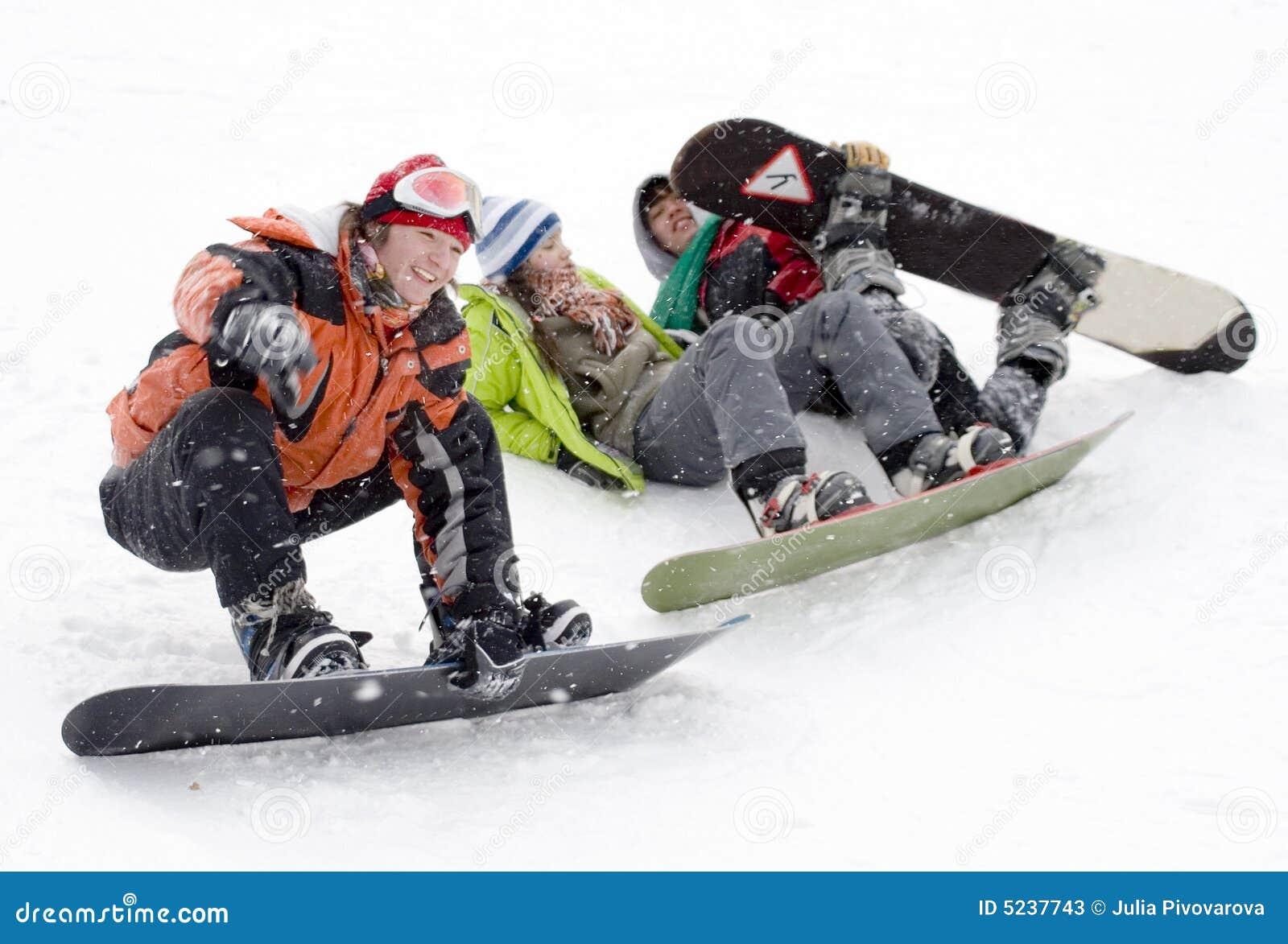 Group of sports teenagers snowborders
