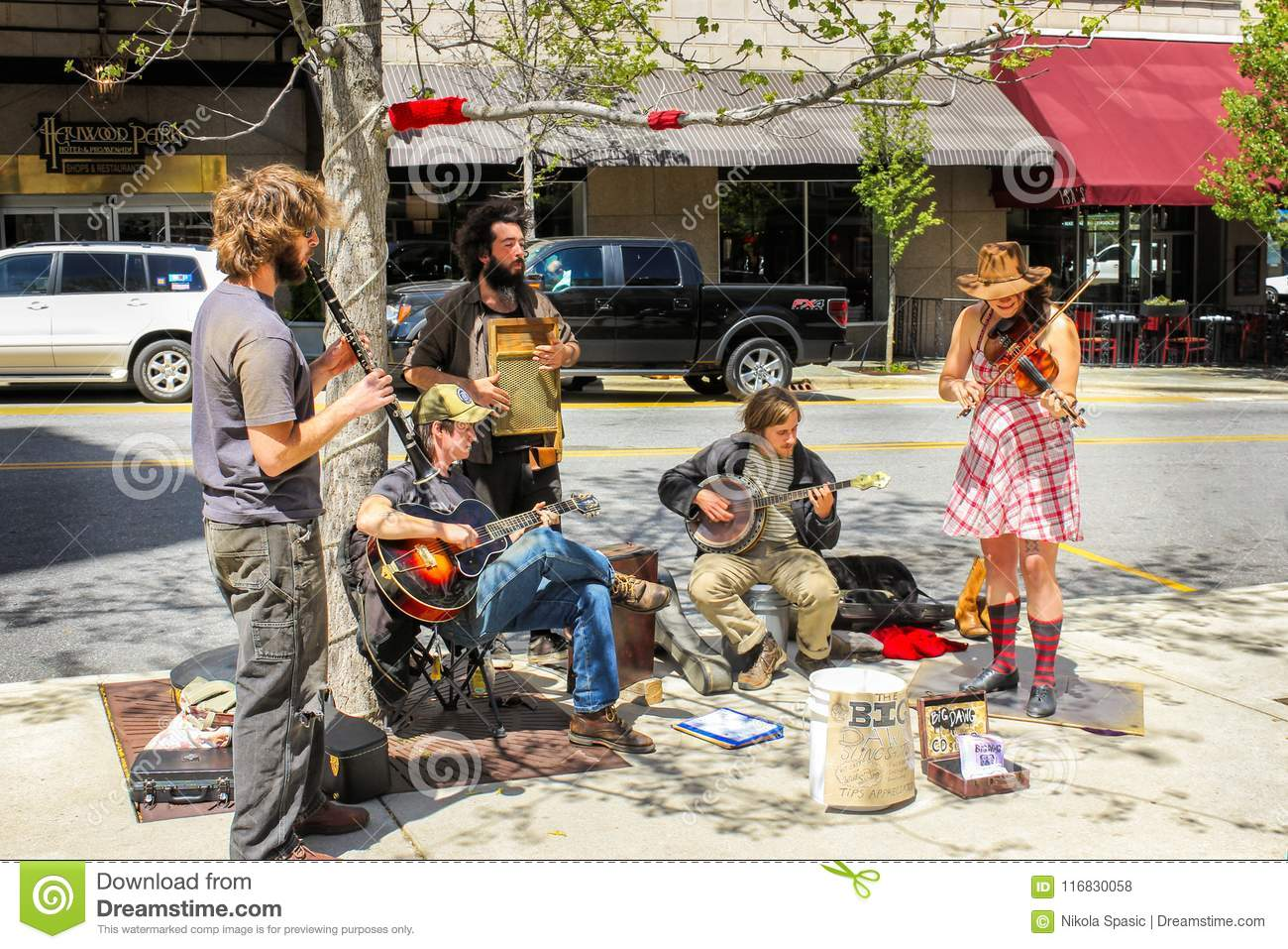 A group of street performers playing on instruments in Asheville in North Carolina