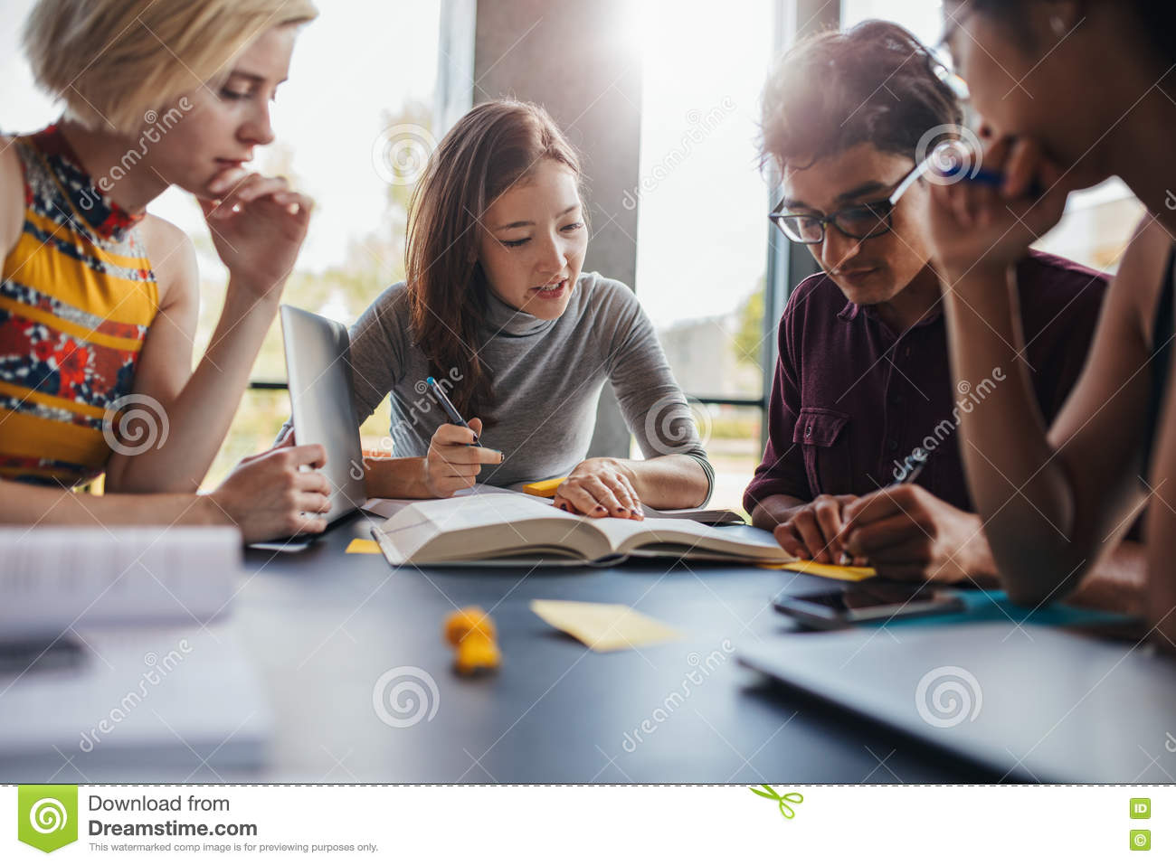 Group of students doing school assignment