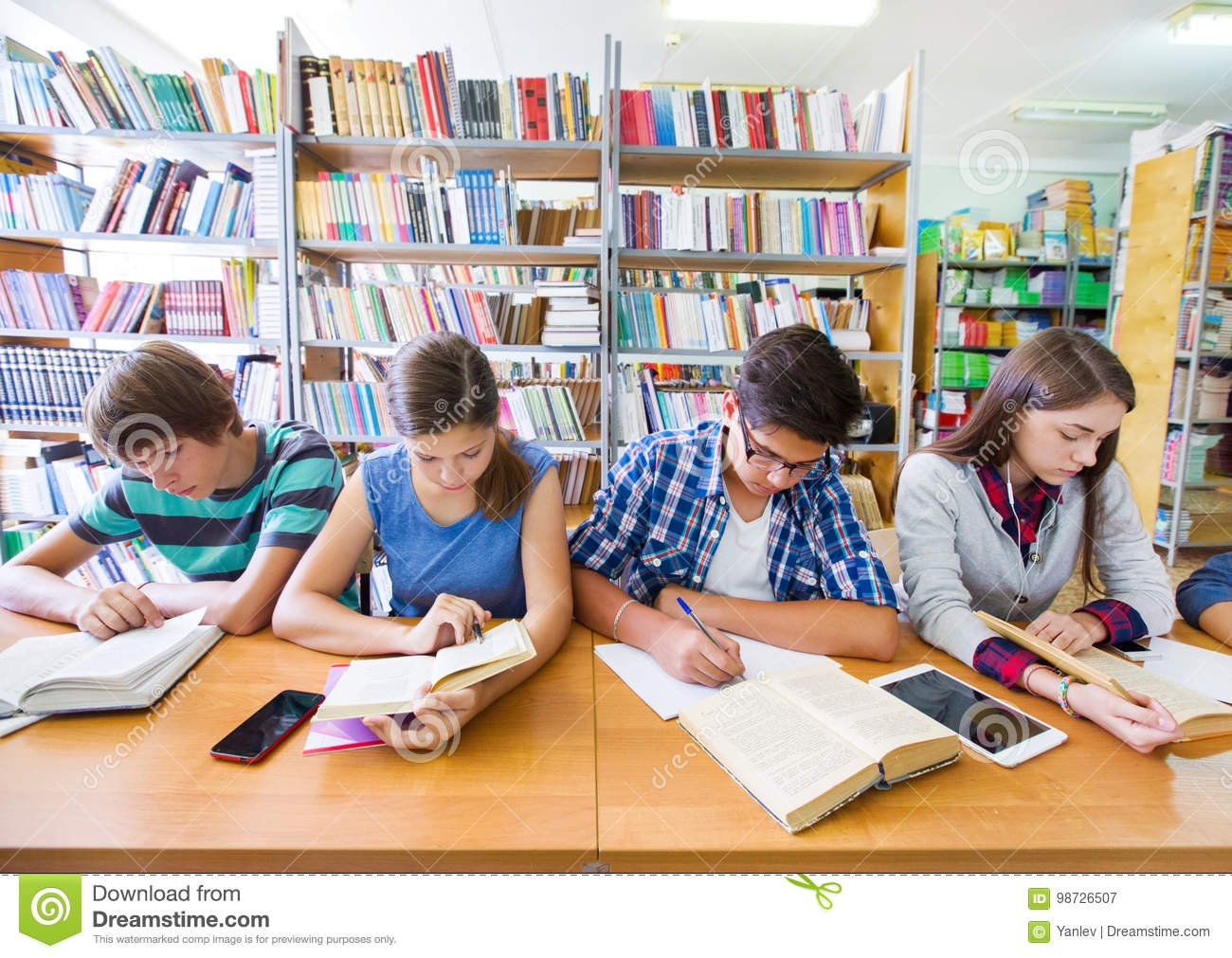 Teens in library stock image  Image of people, learning