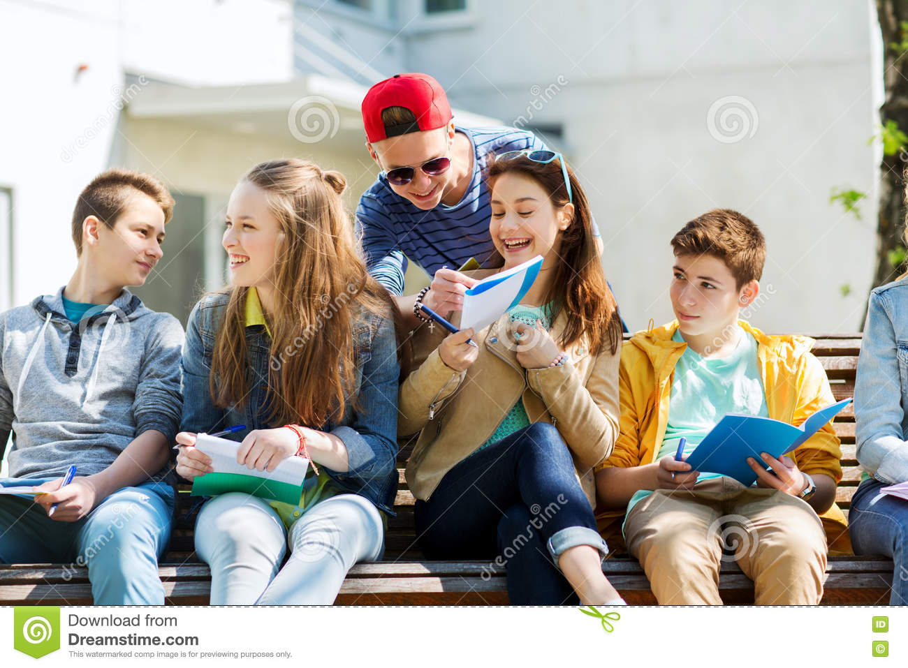 Group of students with notebooks at school yard