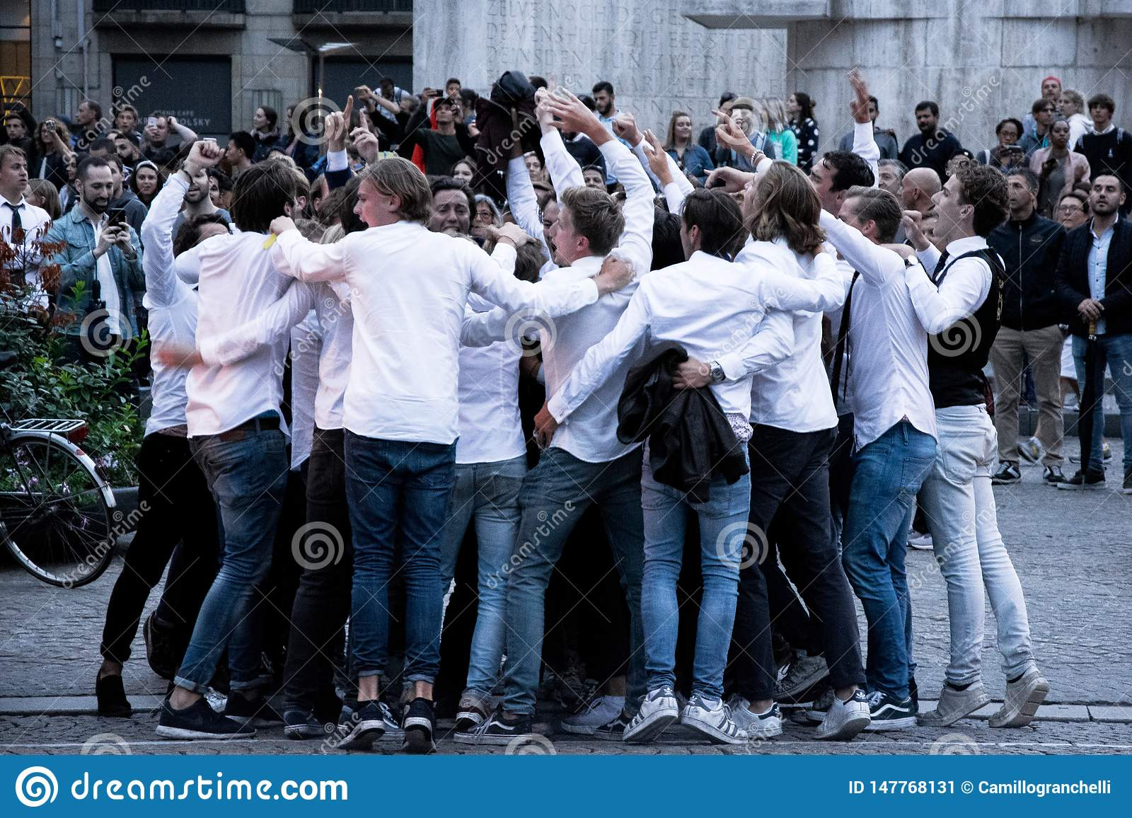 Group of students partying in the street in Amsterdam