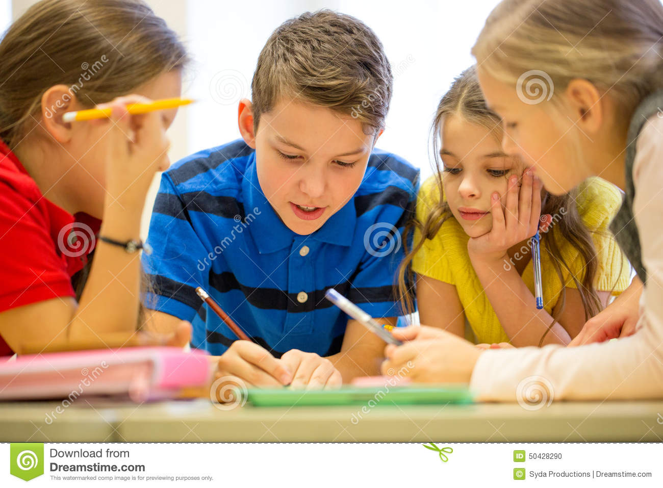 group of students talking and writing at school stock photo - image