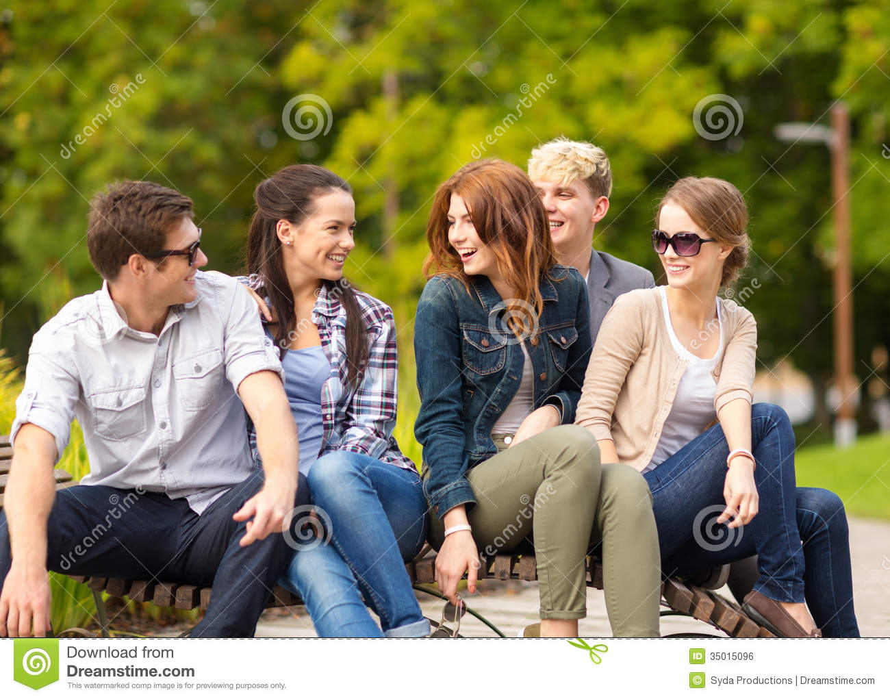 Teens having fun and hanging out outside royalty free for Hanging groups of pictures