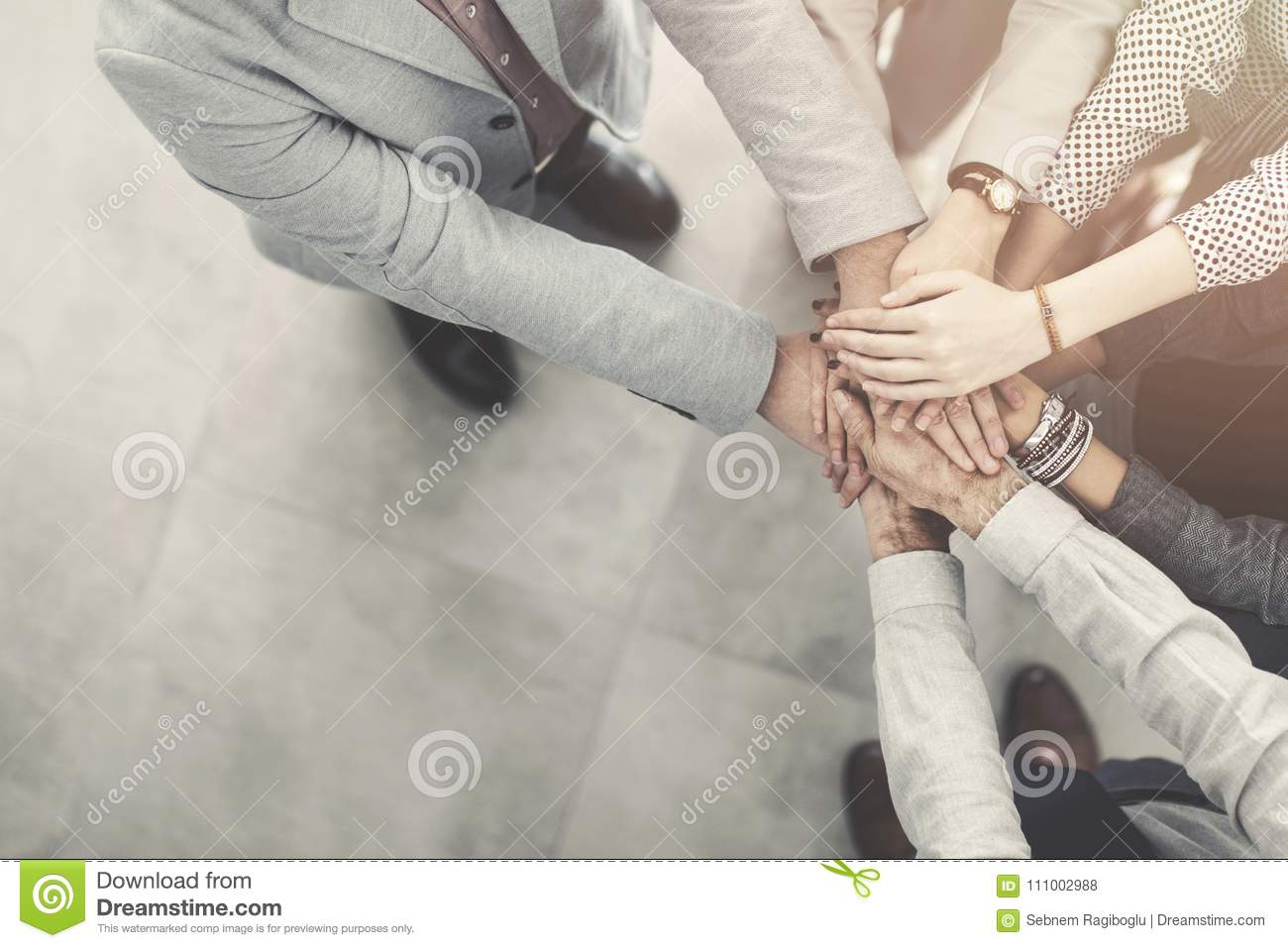 Group of successful business people hand to hand