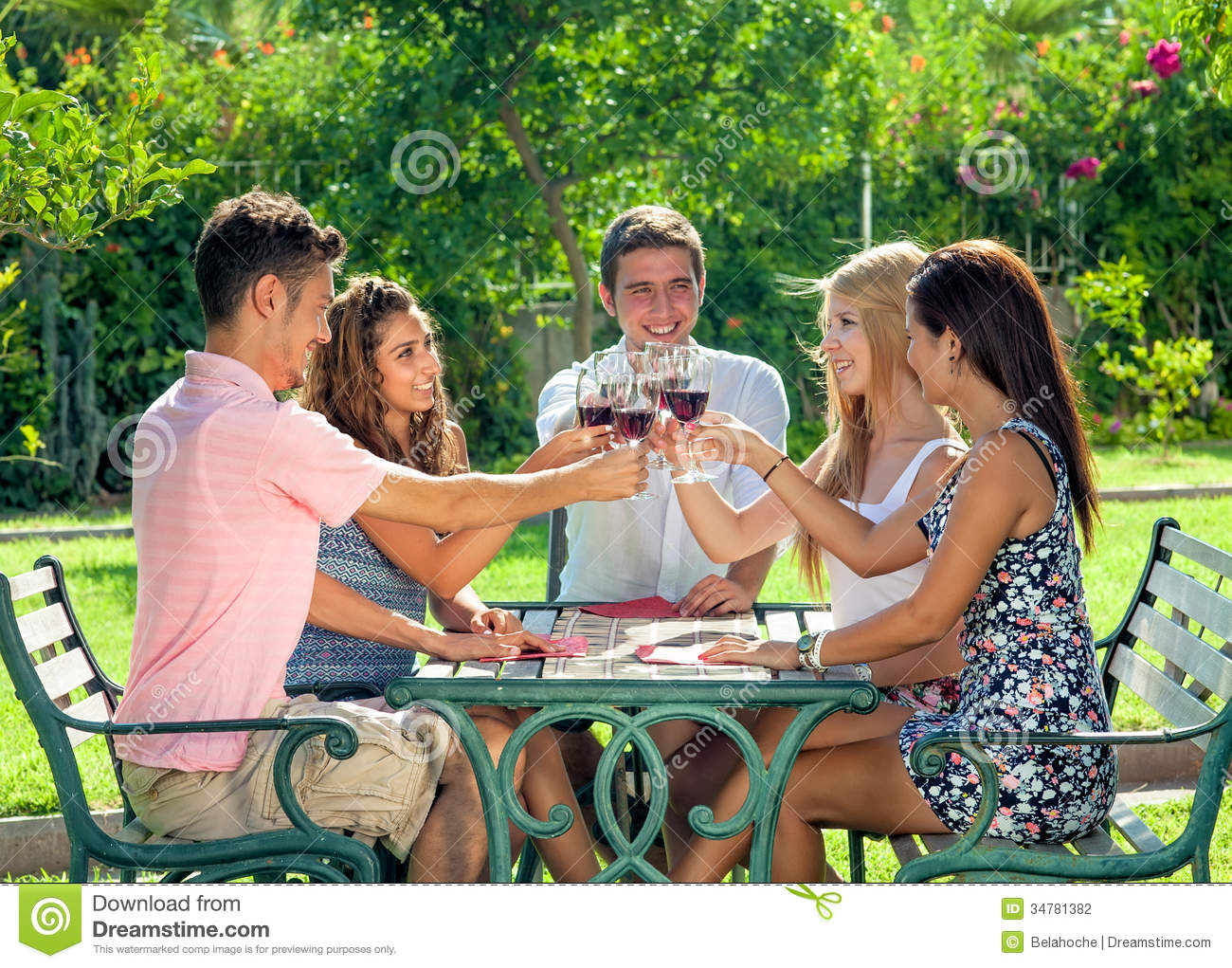 Gardening Group: Group Of Teenage Friends Enjoying A Drink Together Stock