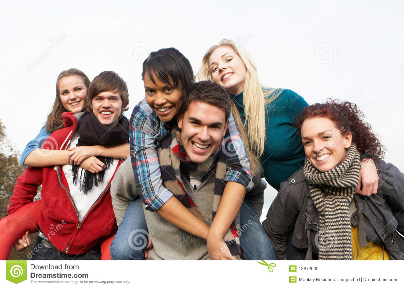 Group of teenage friends having piggyback rides royalty for Hanging groups of pictures