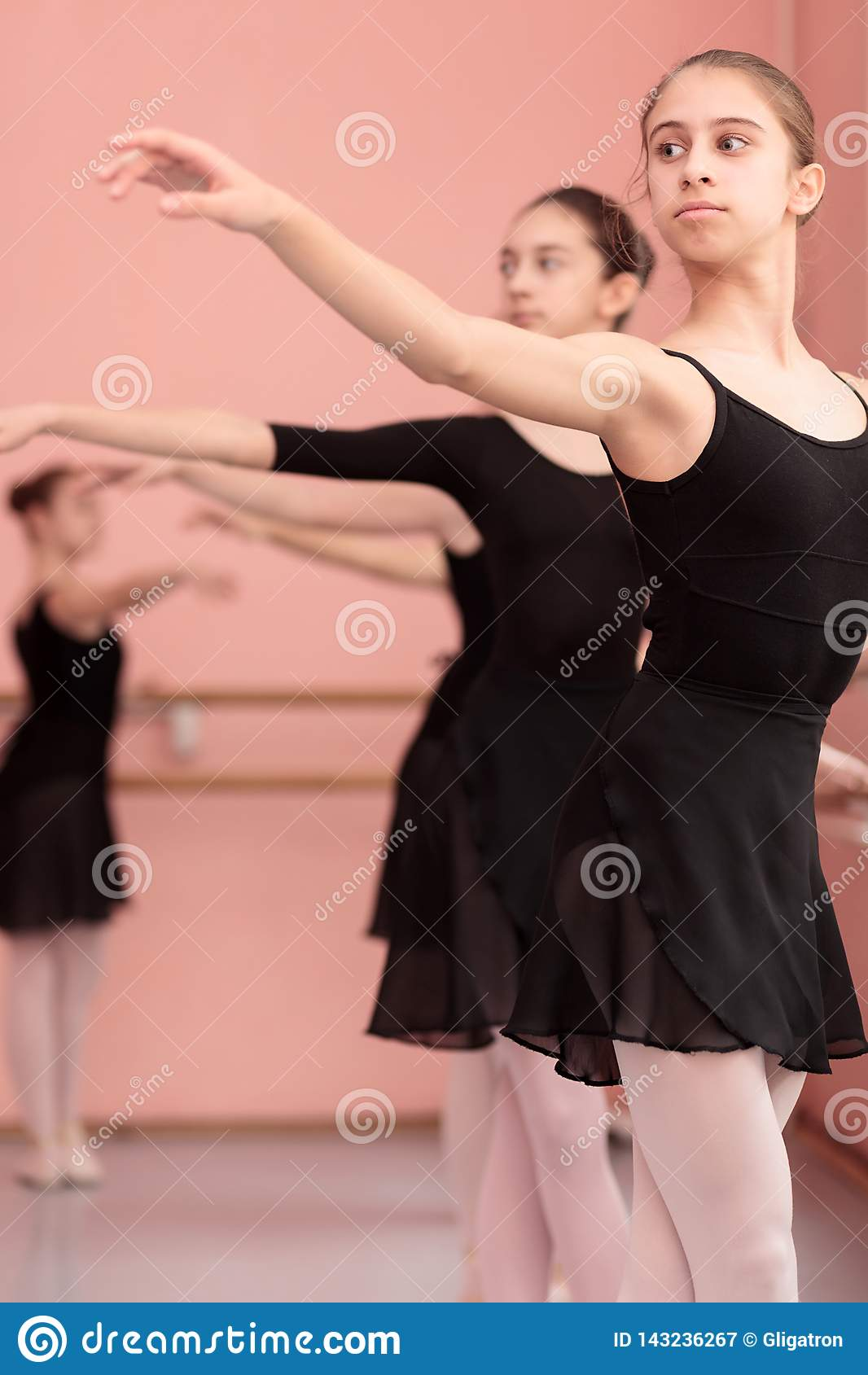 Group of teenage girls practicing classical ballet