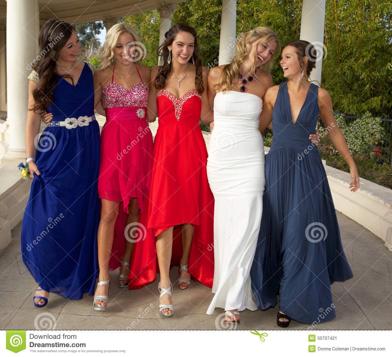 A Group Of Teenage Girls Walking In Their Prom Dresses Stock Image ...