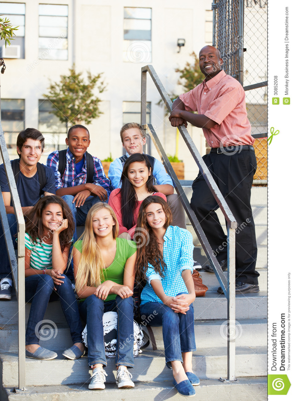 Group Of Teenage Pupils Outside Classroom With Teacher